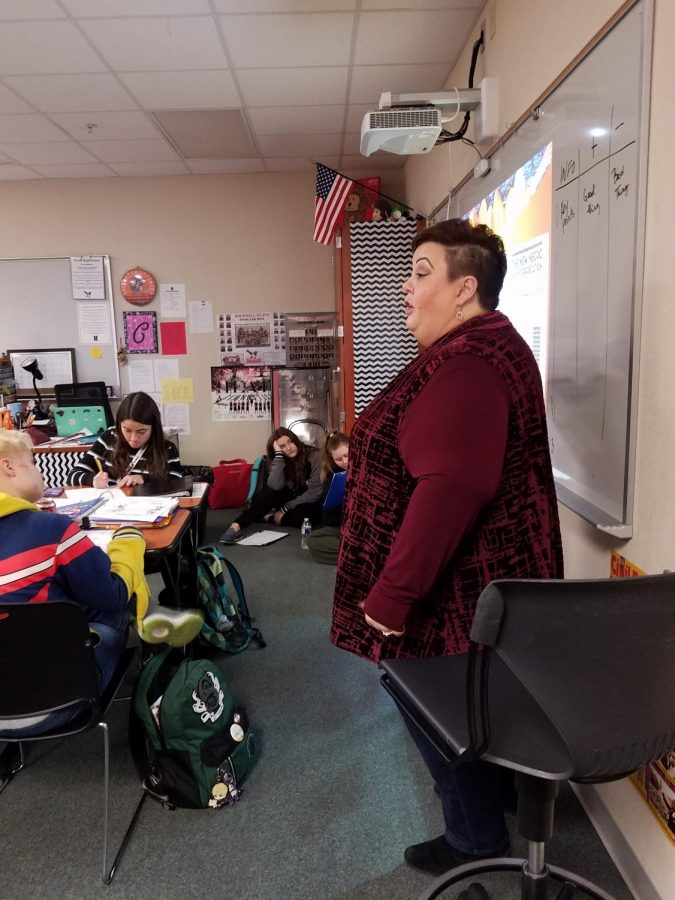 Ms. Carmody  Hands on in the classroom, Ms. Carmody makes sure the students get all of the information they need out of the notes. Gaining the students' attention, she makes it clear by circling and underlining what they need to know in order to be successful this term.