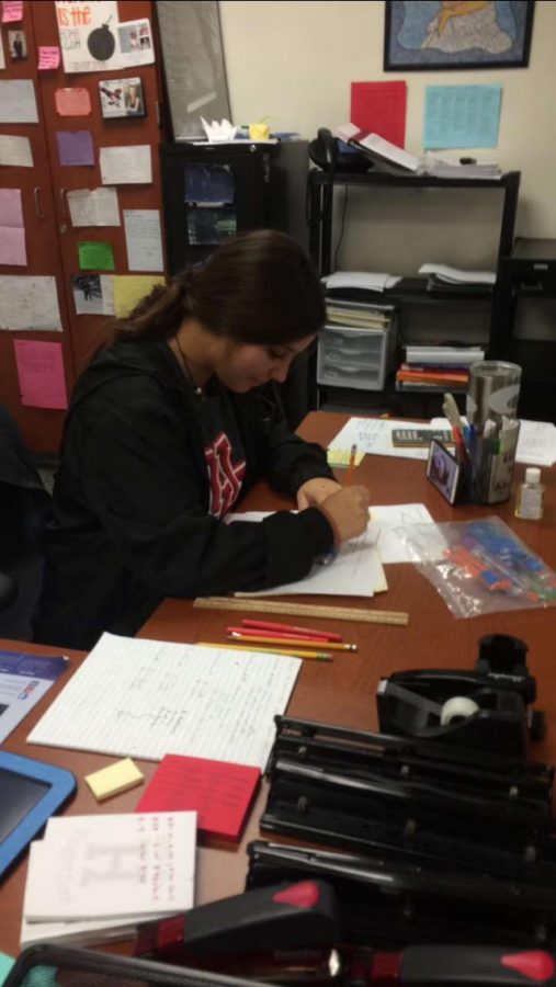 Math is fun! Senior, Abigail Renteria, uses a protractor to solve for the angle of triangles in Coach Rhomer's Precalculus class.