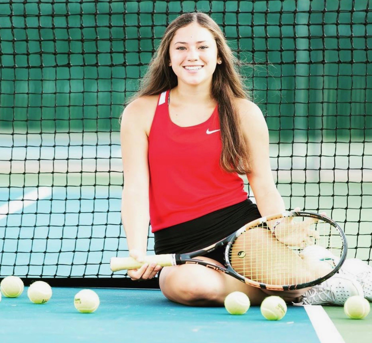 Dani Alexander, a sophomore at Heath High School, who is number two on the varsity tennis team.
