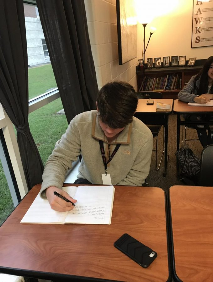 Getting Creative Freshman Will Davis in Mrs Dickens English 1 class is working hard on his warm up by writing creative sentences to prepare for today's activity.