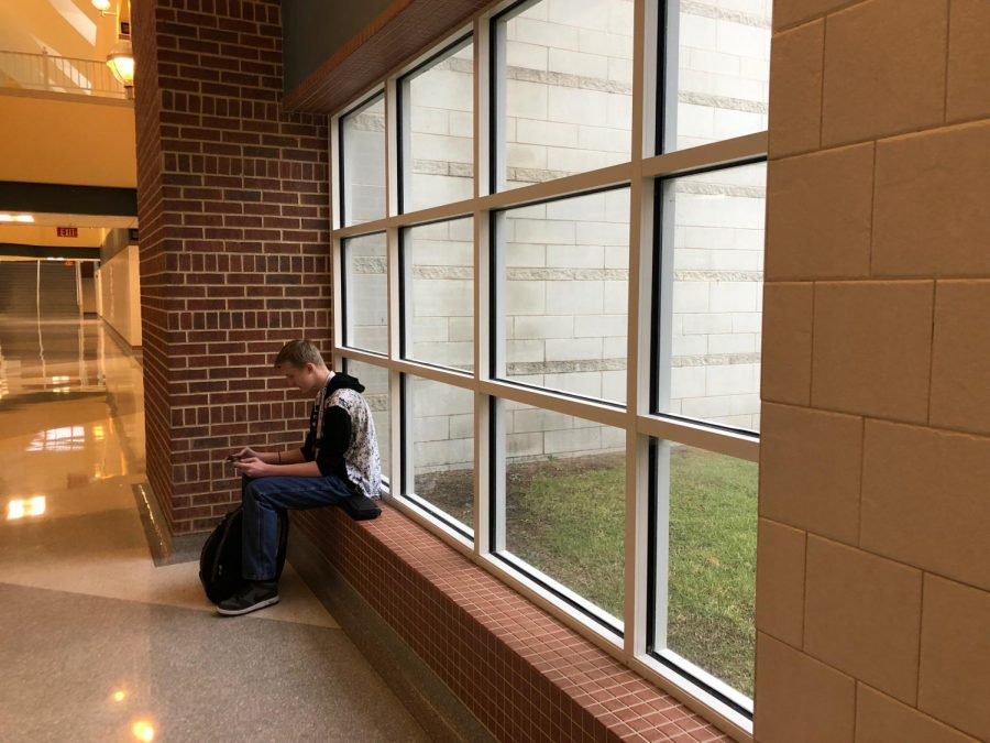 Waiting, gaming Noah Mcginnis, a freshman, waits for his lunch period to be over by playing with his Nintendo Switch, choosing to spend what precious time he may have eating on a mind-break from a full day of studying.