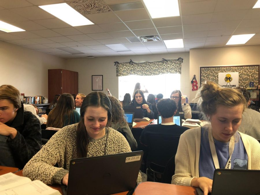 Poets in the Making AP Literature students Peyton Washburn and Kaitlin Fisher work on a poetry assignment for class. Teachers all over Heath are hoping to establish a lasting desire for learning in their students through exposing them to all types of literature.
