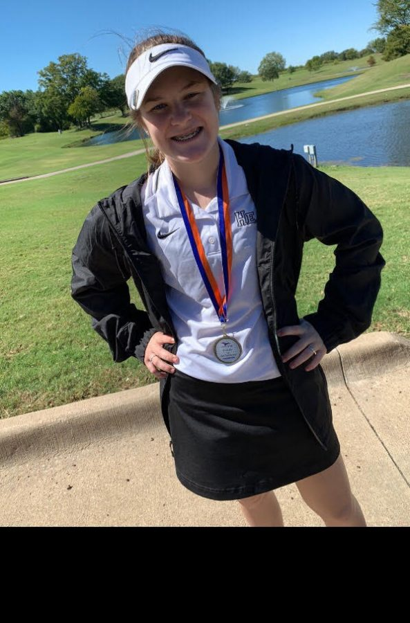 Winning the Gold Hudson Woloss, a freshman, wins first place with a score of 51 at a 9 hole Waterview tournament for Rockwall Heath High School Junior Varsity Girls Golf.