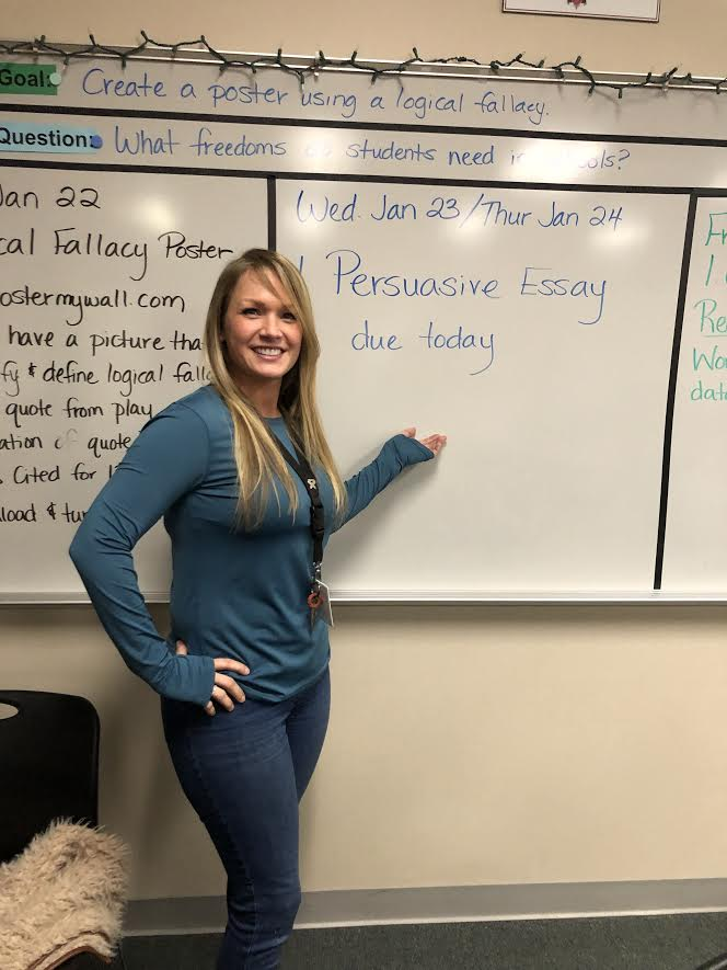 Telling all// freshman English teacher, Christal Woods is telling her students what the objective for the day is.