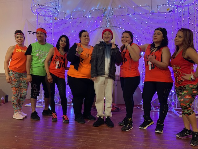 A smile that touches the community// Rodrigo dances with the Zumba dance team at an event his friends and family hosted for his cause. Mr. Johnson, a special education faculty member describes this event as,