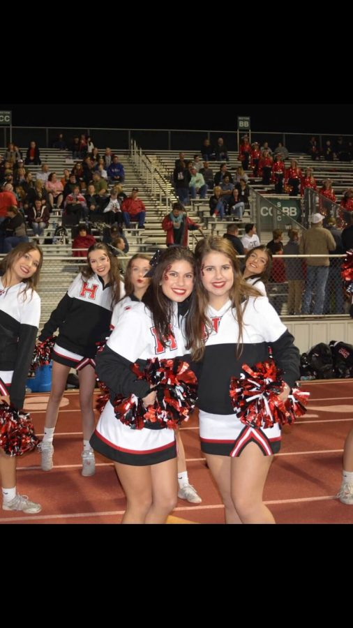 Taking on the team // Carmen Perez, senior, left, poses with other Rockwall-Heath cheerleaders. The cheerleaders influenced my high school experience by giving me the opportunity to show my spirit, and how great fun I am for RHHS, said Carmen.