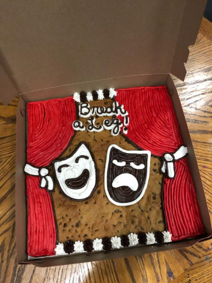 The+cookie+to+remember+%2F%2F+Supporting+the+theater+department%2C+senior+Dominick+Tan+has+a+cookie+cake+made+for+some+of+his+fellow+classmates+performing+the+one-act+play.+Many+of+the+classmates+enjoyed+the+cookie+cake+as+it+brought+smiles+backstage+before+the+performance.+%E2%80%9CThe+cookie+cake+was+actually+pretty+good.+It+wasn%E2%80%99t+extremely+sweet+as+the+one+in+the+mall+but+it+was+actually+semi-sweet+to+where+you+could+keep+on+having+more+slices%2C%E2%80%9D+said+senior+Dominick+Tan.%0A