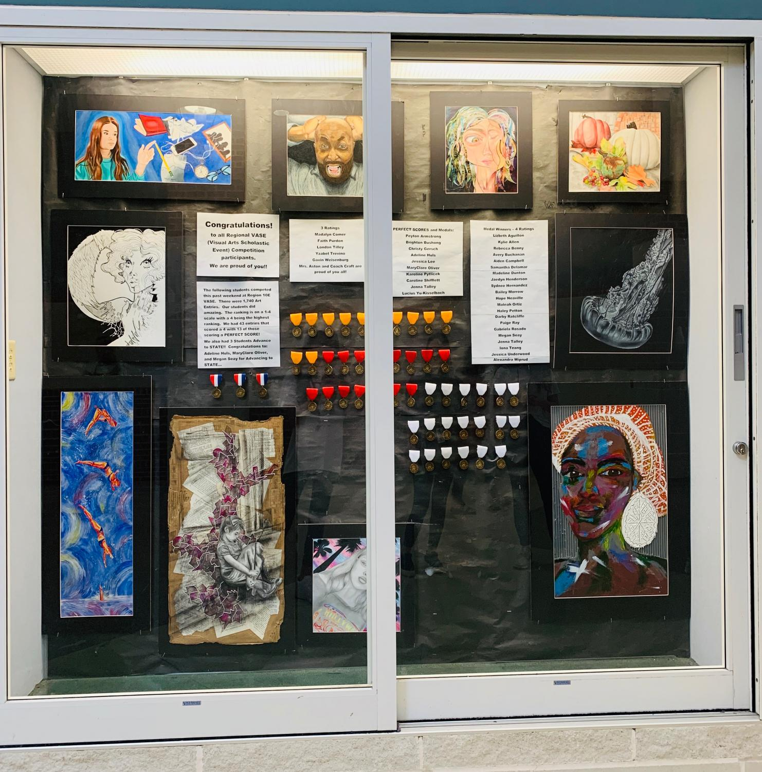 """Expressing creativity// Heath High School is one of the 21 schools that is represented in the 2019 Rockwall ISD District Art Show. Families and friends can come view the art of students throughout all of Rockwall. """"The District Art show is an amazing opportunity that enables the students of Rockwall ISD to showcase their artwork to the community. I really enjoy seeing the entire district coming together exhibiting various forms of art, both 2D and 3d, from K-12th grade,"""" said Julia Deleon."""