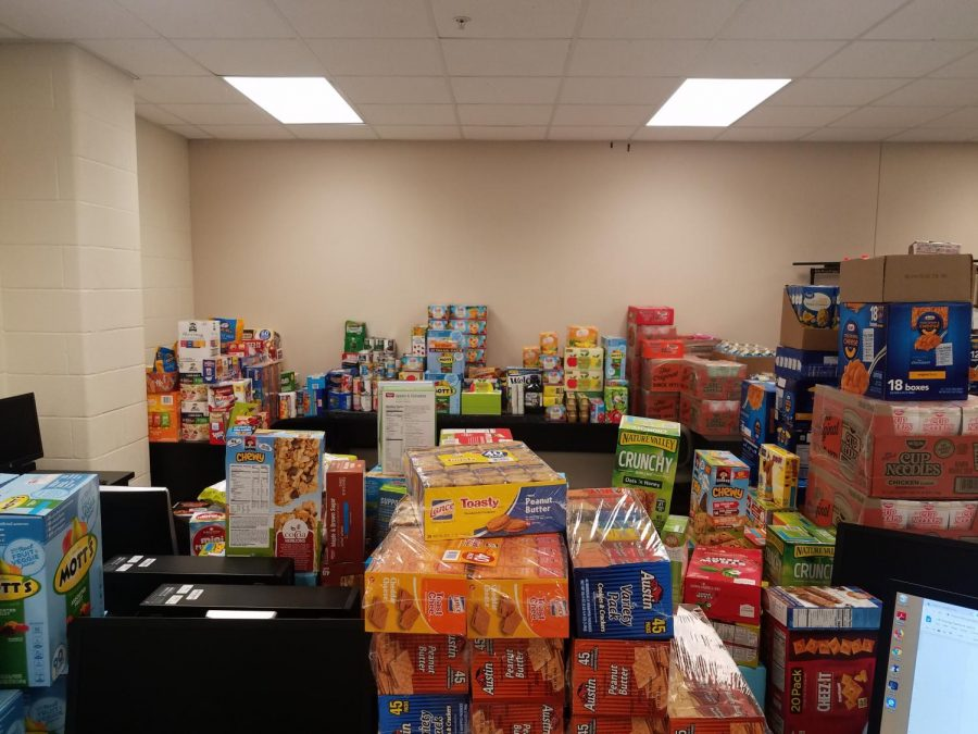 """Help as a whole // As Mrs. Spampinato's room begins to fill up with food, she still makes an effort to collect as many donations as possible. Donating food to the HAWKS Care program, Sydney Calk makes an impact and wishes to do more for the community. """"I was inspired to donate to this program because I was always taught to give back to my community. I am fortunate enough to not have to worry about being hungry and I love being able to help people and prevent hunger in our community,"""" Sydney Calk said."""