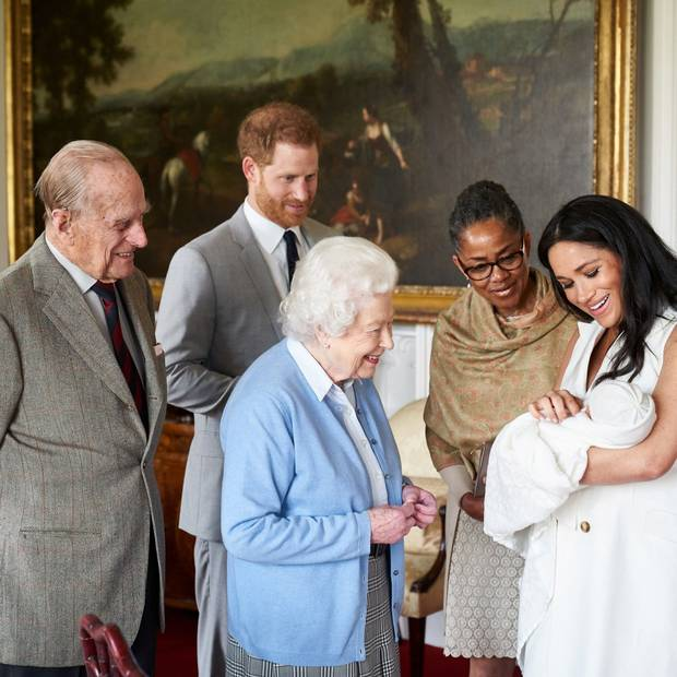 "Spring baby// New royal baby, Master Archie Harrison Mountbatten-Windsor, meets his great grandparents, the Queen of England and Prince of Wales. Elle magazine says, according to a source, "" He [Prince Harry] said he just feels part of the family, and can't imagine life without his son."""