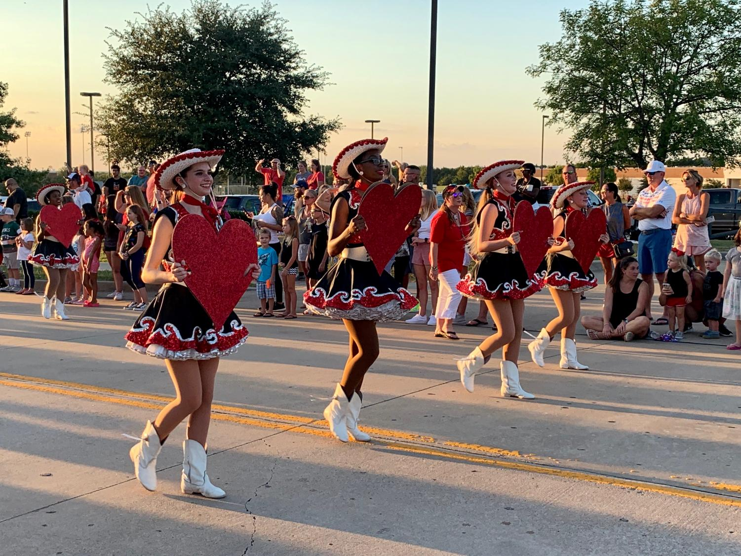 "Three more days// Rockwall-Heath High School had their first Homecoming Parade in years. Many people came out to support students and to show school spirit three days before the big night. ""That was great,"" said Joan Haddock."