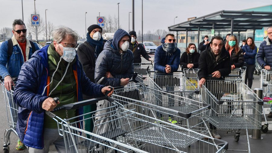 Residents wait to be given access to shop in a supermarket in small groups of forty people on February 23, 2020 in the small Italian town of Casalpusterlengo, under the shadow of a new coronavirus outbreak, as Italy took drastic containment steps as worldwide fears over the epidemic spiralled. (Photo by Miguel MEDINA / AFP) (Photo by MIGUEL MEDINA/AFP via Getty Images)